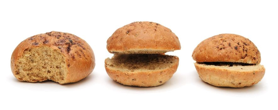 Three funny cut flax burger buns for a hamburger isolated on a white background.