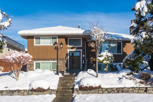 Average family house in snow on winter season