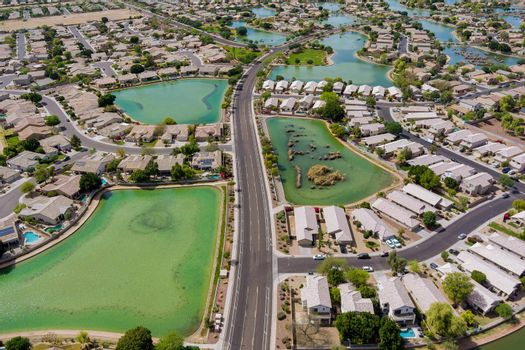 Panoramic view of neighbourhood single-family over suburban homes in residential area near many small pond with Avondale town Arizona USA