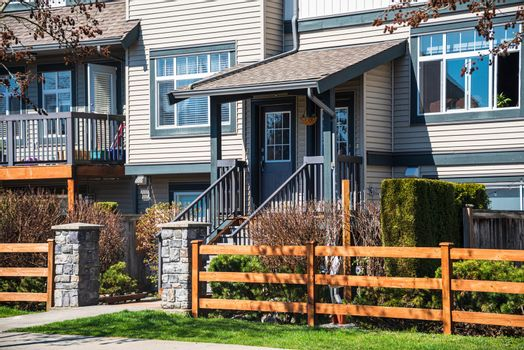 Wooden front yard fence and entrnace of residential townhouse