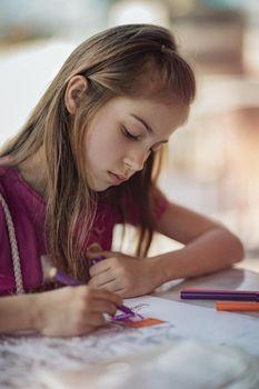 Girl Draws in Coloring Book