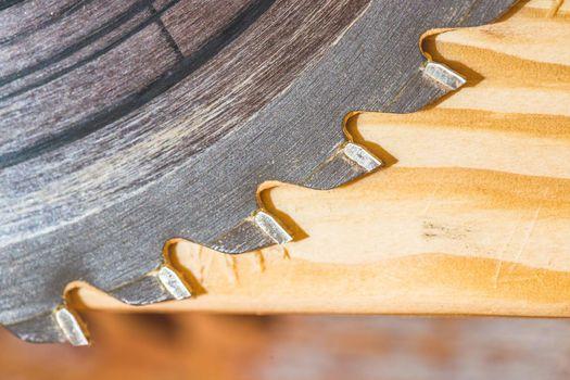 Woodwork at a carpenter: Close up of circular saw blade