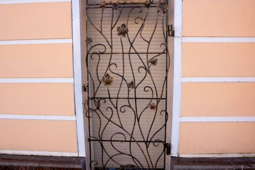 Decorative elements of buildings, old cast-iron wrought-iron grilles on doors and gates.