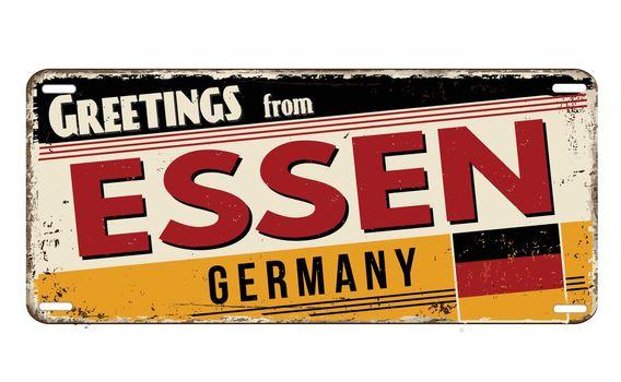 Greetings from Essen vintage rusty metal plate