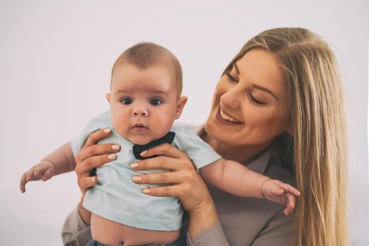 Happy mother and her baby boy at home.