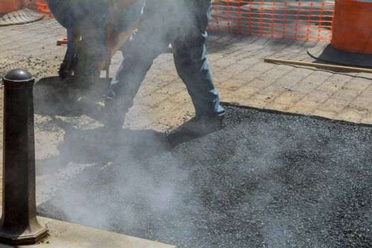 New road construction a repair asphalt covering while laying asphalt a special tool takes