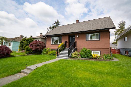 Average brown residential house built on land terrace
