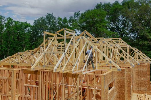 Unfinished of view of a house residential construction roof of framing against