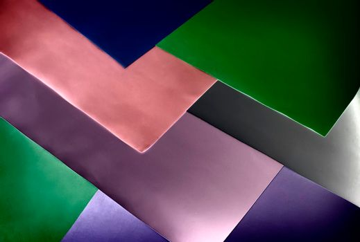 Abstract image in geometric style with bold, overlapping lines of different colors.