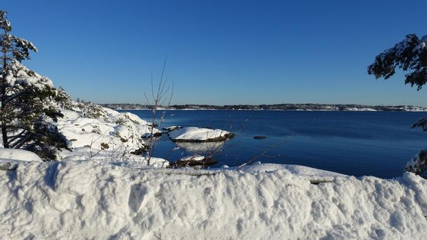 A sunny winter day by the sea in Scandinavia