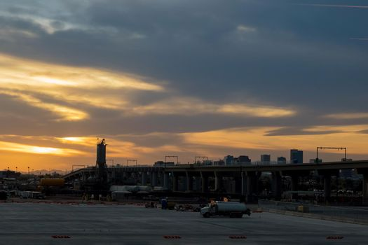Airplane at the terminal gate international airport during sunset travel around the world