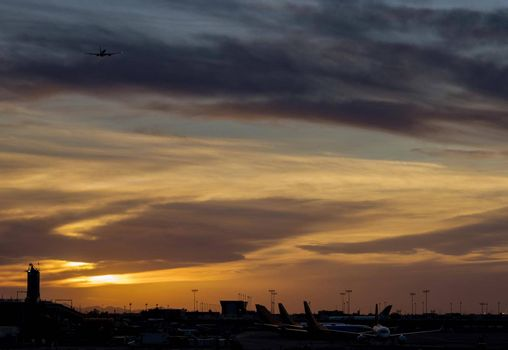 Airport during sunset with takeoff airplane the runway airport boarding gate