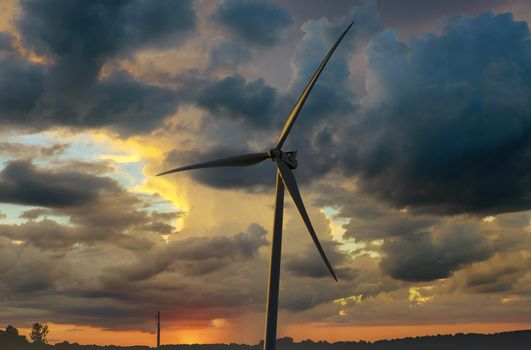 Agriculture field landscape with wind turbines windmill energy farm the beautiful sunset in Texas US