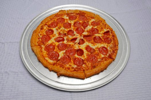 Delicious tomato sauce cheese covered hot and tasty pepperoni pizza pie