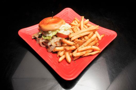 Delicious mushroom and swiss cheese burger with all the fixings on a bun