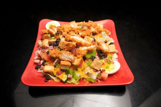 Delicious and delectable dish known as a fried chicken salad