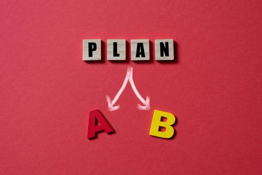 Wooden alpahabet tiles with plan A or B.