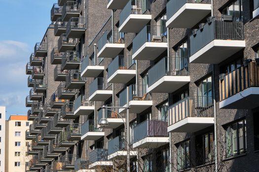 Modern gray apartment building made of bricks