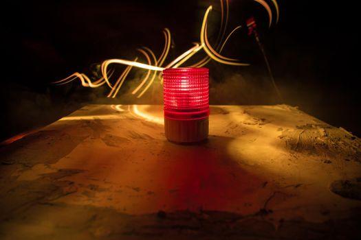 Emergency lighting in the factory, Warning light, Orange siren on concrete wall. Rotating siren.