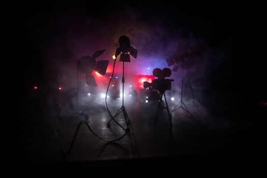 Action movie concept. Police cars and miniature movie set on dark toned background with fog. Police car chasing a car at night. Scene of crime accident. Selective focus