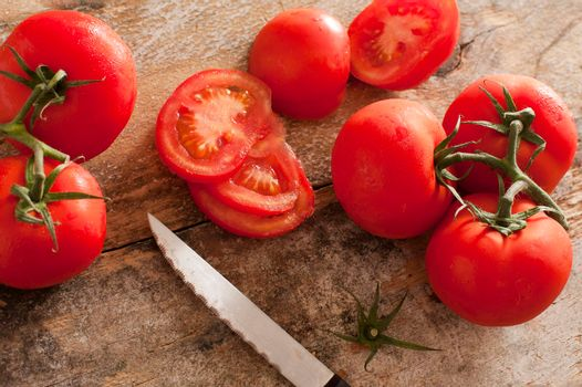 High-angle view of tomatoes on rustic wooden table