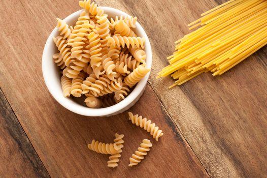 Dried Italian spiral fusilli and spaghetti pasta