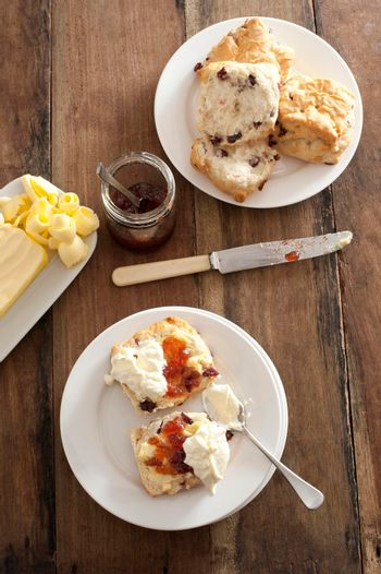 Rock cakes or raisin buns with jam and cream
