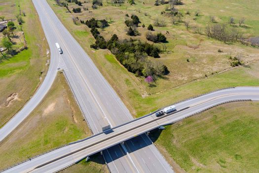Aerial view of highway road of transport junction from the height drone