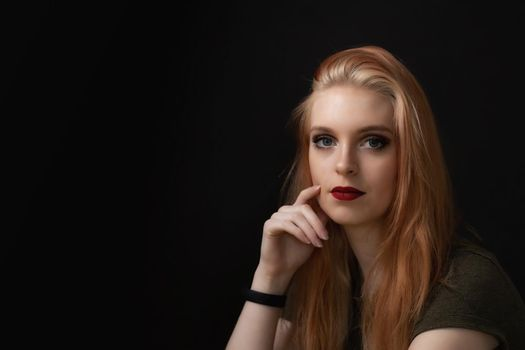 Low key portrait of attractive young woman.