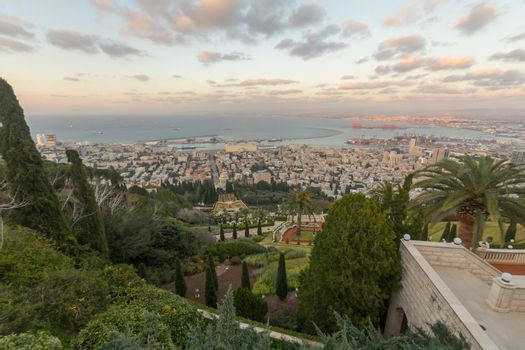 Sunset view of Bahai Shrine, gardens, downtown and port, Haifa