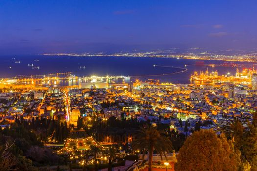 Night view of Bahai Shrine, gardens, downtown and port, Haifa