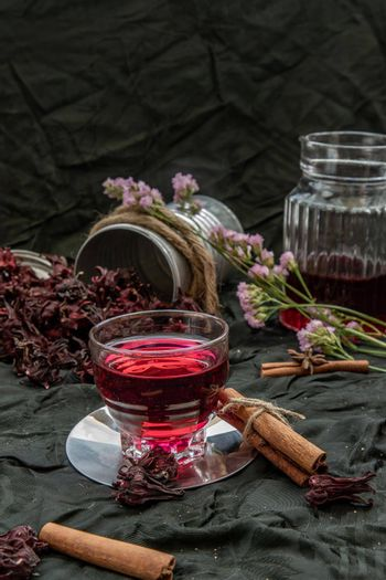 Roselle tea (Jamaica sorrel, Rozelle or hibiscus sabdariffa ) with dry roselle and brown cane sugar cube. Healthy herbal tea rich in vitamin C and minerals. The concept of health. Organic and Summer drink, Drinks & Beverages, Selective Focus.
