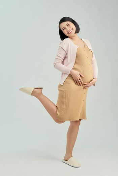 Pregnant woman wearing maternity dress