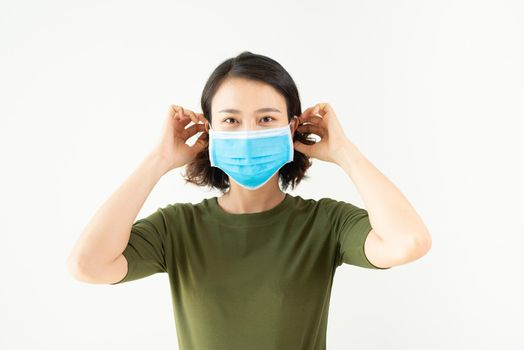 Asian woman wearing facial mask for protection from air pollution or virus epidemic on white background