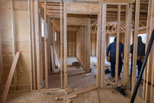 Interior new residential beam wood framework of home under construction