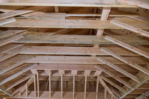 Roof wood framework of home under construction in progress new residential beam