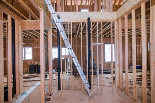Beams framing of a new unfinished wooden house under construction