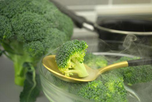 Fresh broccoli florets on a spoon