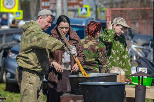 Reconstruction of the Second World War. Field kitchen, preparing food for the soldiers. The Great Patriotic War. Liberation of Odessa. Zelenograd Russia April 18, 2021