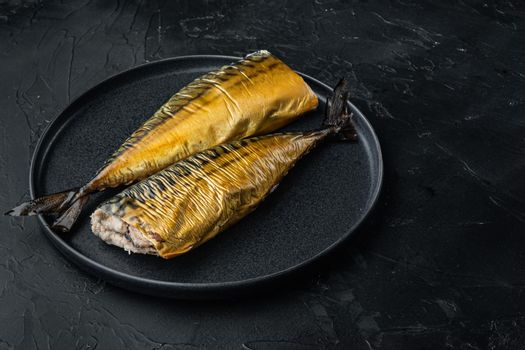 Appetizing smoked fish, on black background
