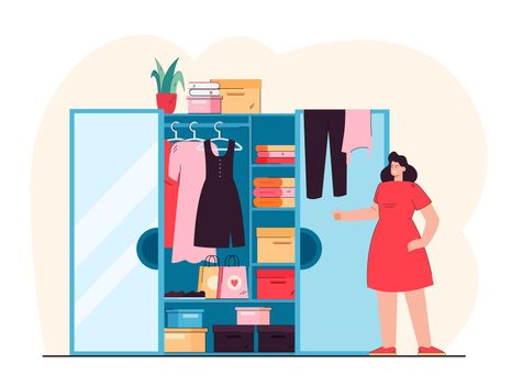 Smiling woman standing in front of open wardrobe