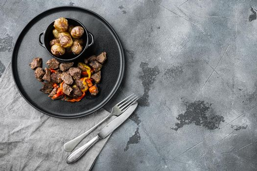 Goulash, beef stew, on gray stone background, top view flat lay, with copy space for text