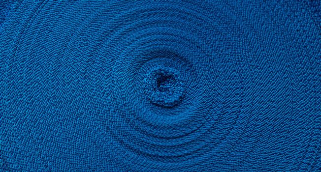 Blue abstract circular pattern of blue sling.