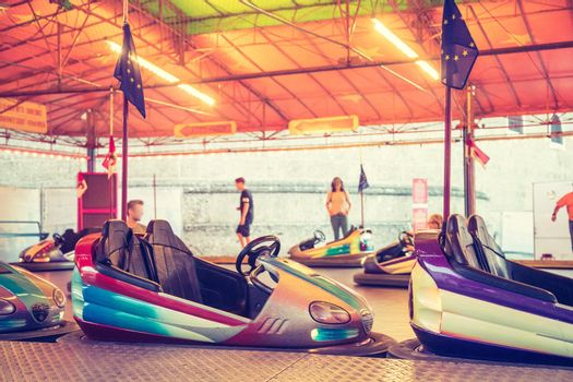 Bumper car at Oktoberfest: Colorful electric bumper car in autodrom