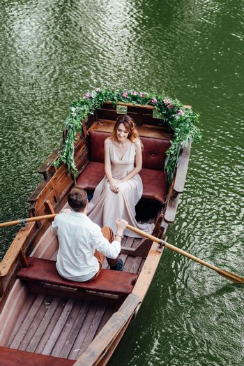 a boat trip for a guy and a girl along the canals and bays of the river