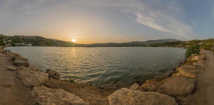 Panoramic sunset view of Lake Ram in the Golan Heights