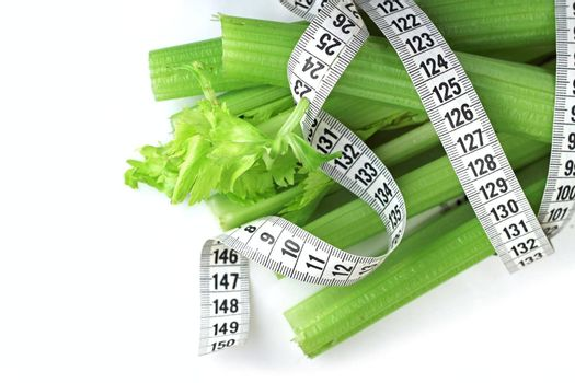 Celery and measure tape diet weight loss concept isolated on white background
