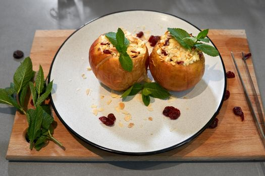 Baked apples with cottage cheese and with fragrant mint.