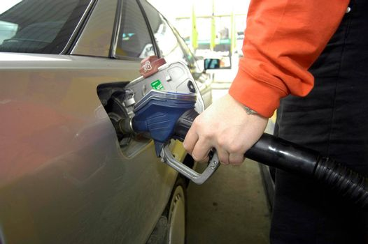 tank nozzle when refueling a car at a gas station