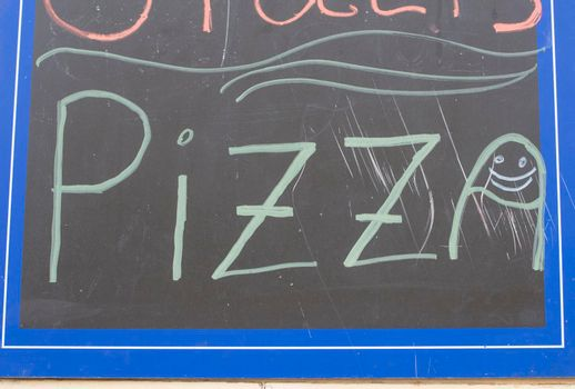 pizza sign at a restaurant, popular food to eat when hungry